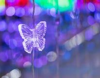 蝴蝶水晶和抽象轻的bokeh 库存照片
