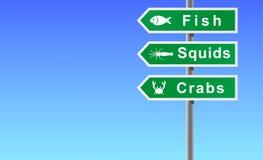 螃蟹鱼签署乌贼 免版税库存图片