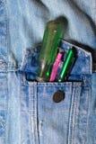 螺丝刀和笔在口袋斜纹布投入了 库存图片