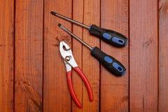 螺丝刀和钳子 图库摄影