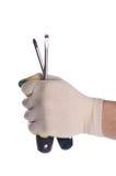 螺丝刀在一个人的手上 免版税库存照片