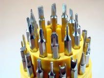 螺丝刀设置了技术员的螺栓修理 图库摄影