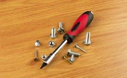 螺丝刀以不同与喷管和螺栓 图库摄影