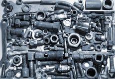 螺拴螺母和机械零件的抽象构成 免版税库存照片