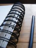 螺旋装订的笔记本和铅笔 库存照片