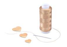 螺纹、针和心脏 库存照片