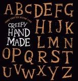 蠕动的古老手工制造字法 皇族释放例证