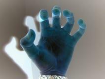 蠕动的蓝色手 免版税库存照片
