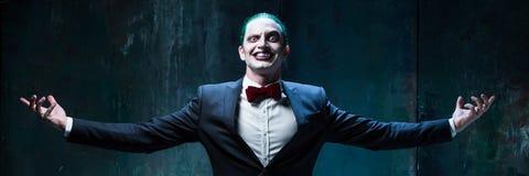 血淋淋的万圣夜题材:疯狂的说笑话者面孔 库存照片