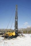 钻行业油西伯利亚适当的西部 根据修理的汽车的流动凿岩机 库存照片