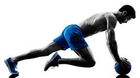 行使健身板条位置锻炼的人 免版税图库摄影