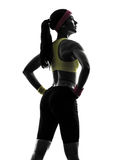 行使健身锻炼常设剪影背面图的妇女 图库摄影