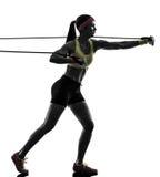 行使健身锻炼抵抗的妇女结合剪影 免版税图库摄影