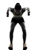 行使健身锻炼重量训练剪影的妇女 免版税库存图片