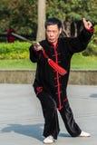 行使tai池氏古城公园上海瓷的一个人 免版税库存照片
