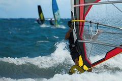 行动的三个风帆冲浪者 库存图片