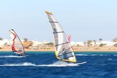 行动的二个风帆冲浪者 免版税图库摄影