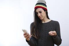行家女孩和哀伤的sms 免版税库存图片