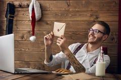 行家年轻人圣诞老人 图库摄影