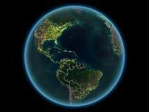 行星地球上的加勒比从空间在晚上 免版税图库摄影