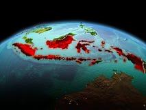 行星地球上的印度尼西亚在空间 免版税图库摄影
