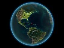 行星地球上的多米尼加共和国从空间在晚上 免版税库存照片