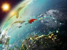 行星地球上的多米尼加共和国在日落 免版税库存照片