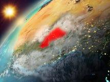 行星地球上的布基纳法索在日落 图库摄影