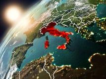 行星地球上的意大利在日落 库存照片