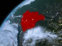 行星地球上的玻利维亚在空间在晚上 库存图片