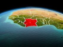 行星地球上的象牙海岸在空间 库存照片