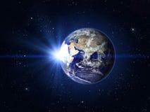 行星地球和太阳 免版税库存照片