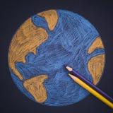 行星地球画与铅笔 免版税库存照片