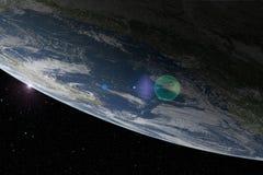 行星地球从上面与透镜火光 免版税库存照片