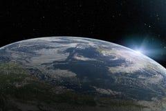 行星地球从上面在空间的日出 免版税库存照片
