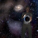 行星盘旋在手之间 免版税库存照片