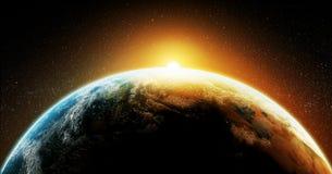 行星从空间的地球日出 库存照片