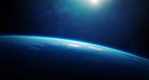行星从空间的地球日出 库存图片
