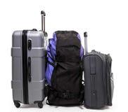 行李背包和两个手提箱 免版税库存照片