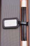 行李黑色皮箱标签 免版税库存图片