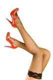 行程红色穿上鞋子妇女的 免版税库存照片