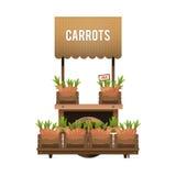 街市 木推车待售红萝卜 出售蔬菜 免版税库存图片