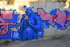 街道一个拖钓妖怪人的艺术绘画 免版税库存图片