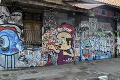 街道在墙壁上的艺术街道画在街道艺术在日惹 免版税库存图片