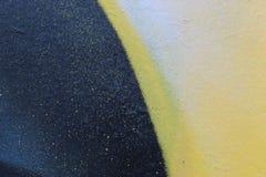 街道画上色墙壁背景的片段纹理 免版税库存照片