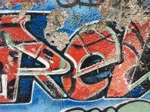 街道画墙壁 都市艺术的背景 无缝的纹理 在墙壁背景的街道画 老被绘的纹理墙壁 库存图片