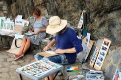 街道画家体会并且卖他们的绘画 库存照片