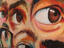 街道画艺术的细节在墙壁上的:多只眼睛 免版税库存照片