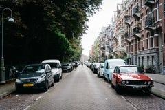 街道的未认出的骑自行车者在阿姆斯特丹 免版税图库摄影