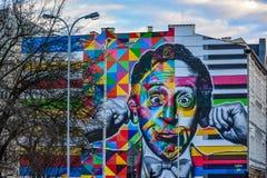街道艺术壁画在罗兹, Sienkiewicza和Traugutta街道的角落的,波兰 免版税库存照片